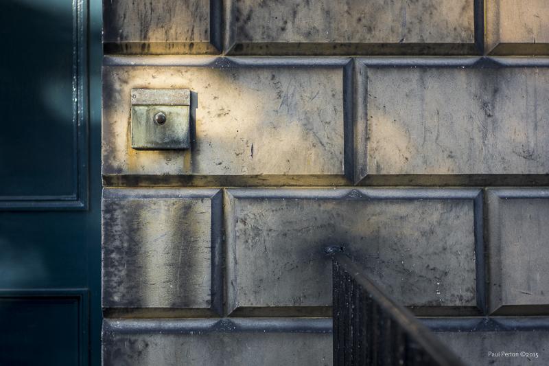 Door, sandstone and bell
