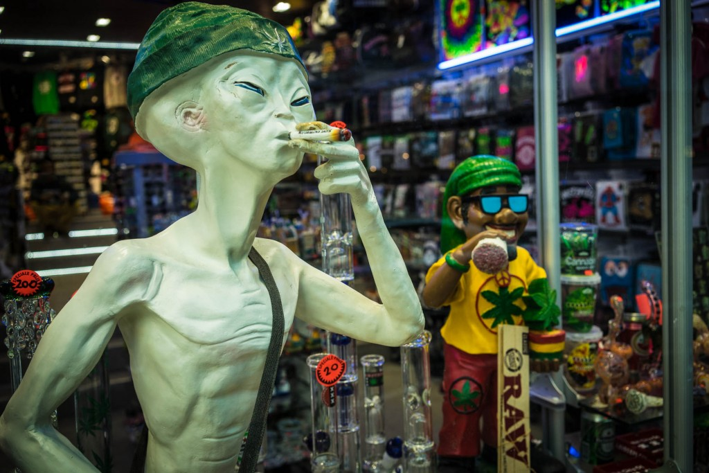 An alien smoking cannabis in Amsterdam with a rasta friend.
