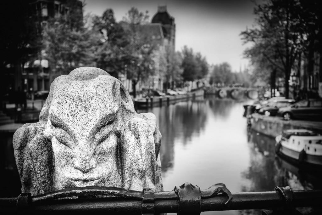 Odd looking bridge face ornament in Amsterdam