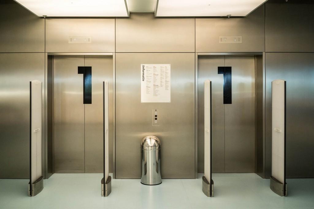 Shiny elevator doors in a very modern lobby in Amsterdam