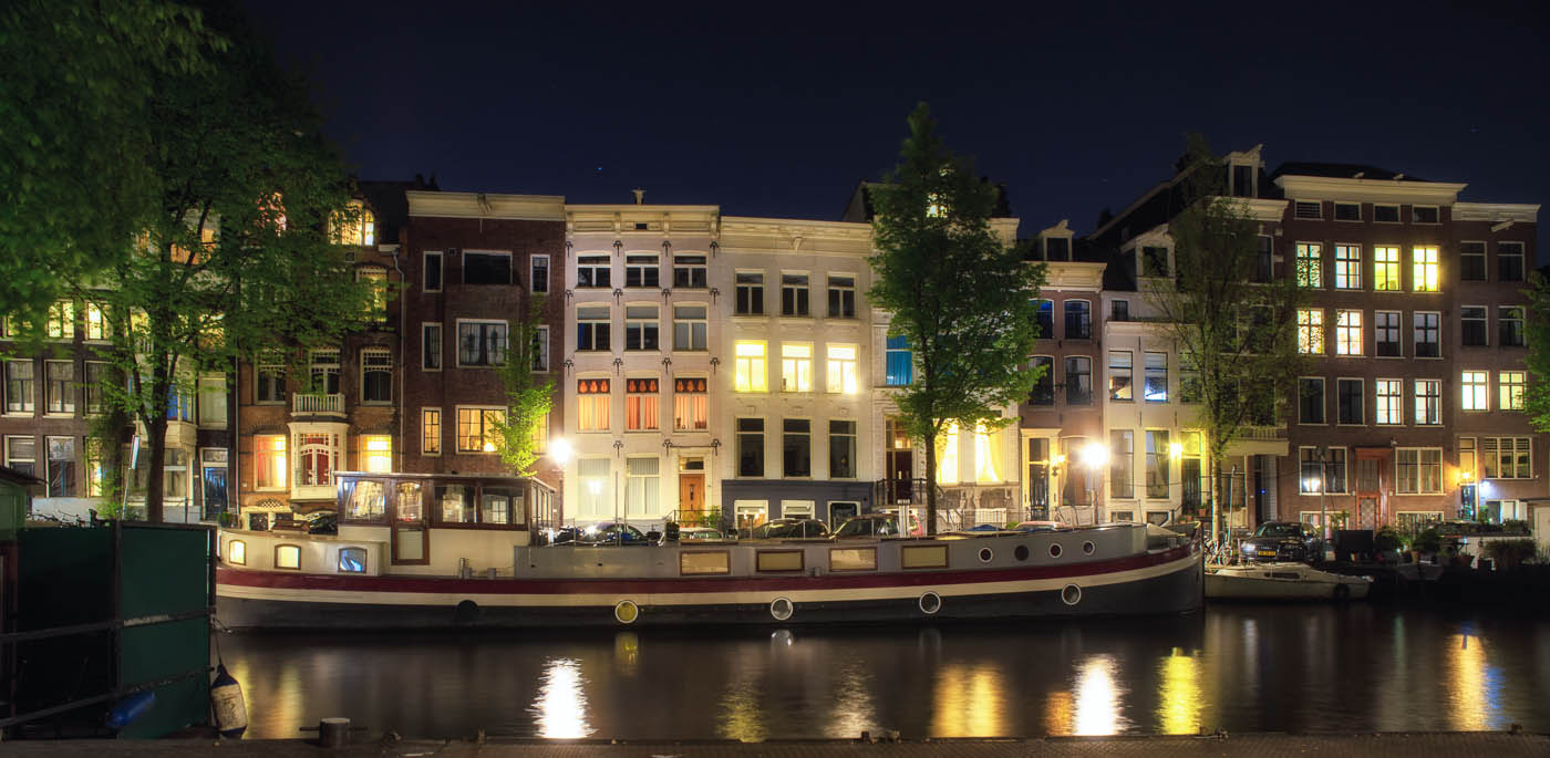 Canal houses and a beautiful barge in Amsterdam