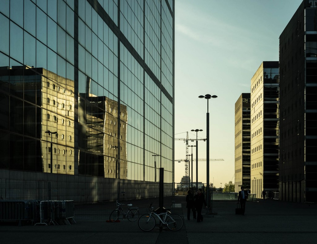 Glass buildings reflecting in the evening light in La Défense, Paris. Zeiss FE 55mm & Sony A7r. Zeiss fe 55mm review