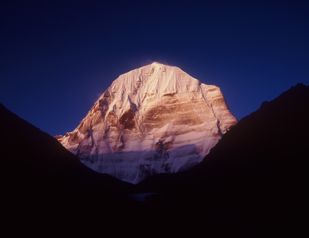 The north face of the holy mountain shot in the brief pre-dawn glow, with spindrift blown from the summit. Fuji GW690, Fuji Velvia 100. (c) Philip Partridge