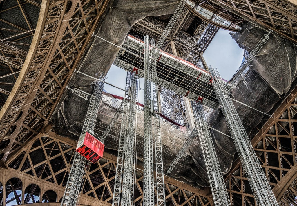 Maintenance work on the Eiffel Tower creates a more interesting photograph than the tower itself