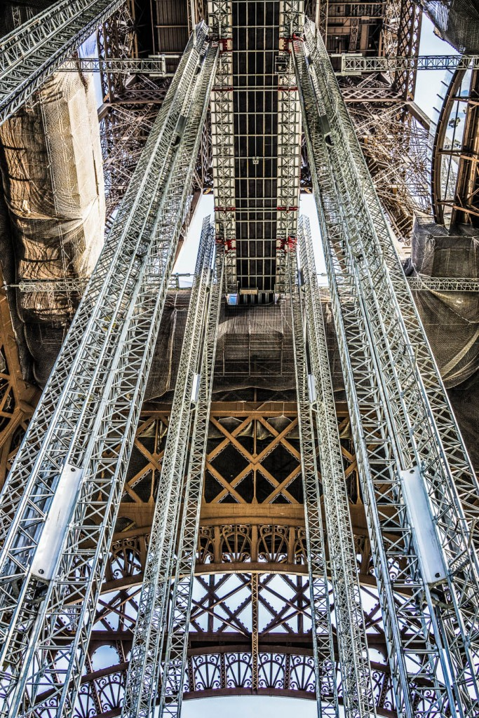 Mintenance work on the Eiffel Tower uses huge metal pillars that provide a very graphical photo opportunity
