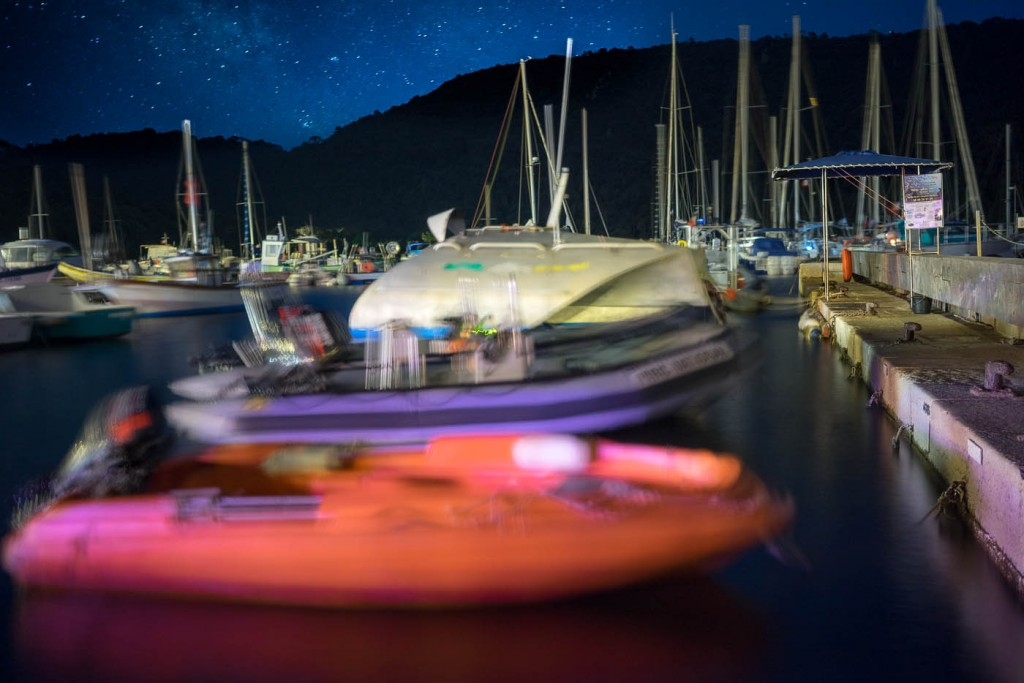 In this long-exposure view of the marina in Port-Cros Island, Provence, at night, the movement of masts and boats blur their outline while constructions remain motnionless