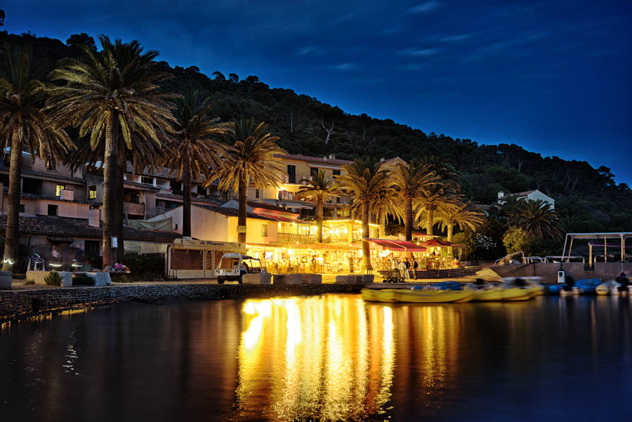 The restaurants on the marina in port-cros, provence, by night