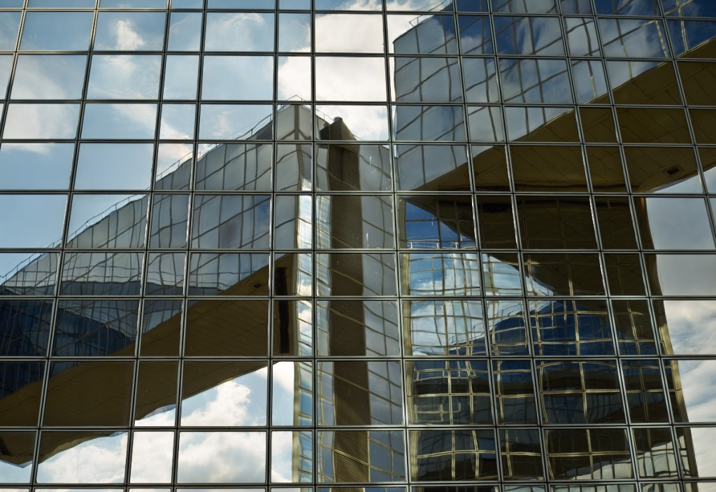 Reflections on a glass building, searching for the perfect camera