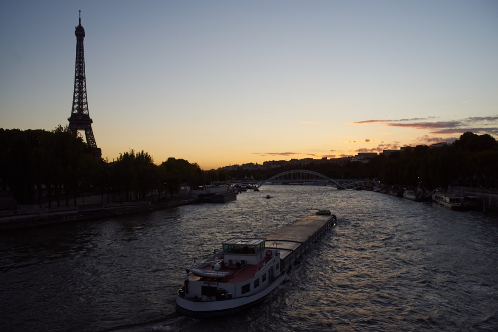 A barge on the Seine river in Paris, facing the Eiffel Tower and the sunset. Perfect camera and perfect scenery.