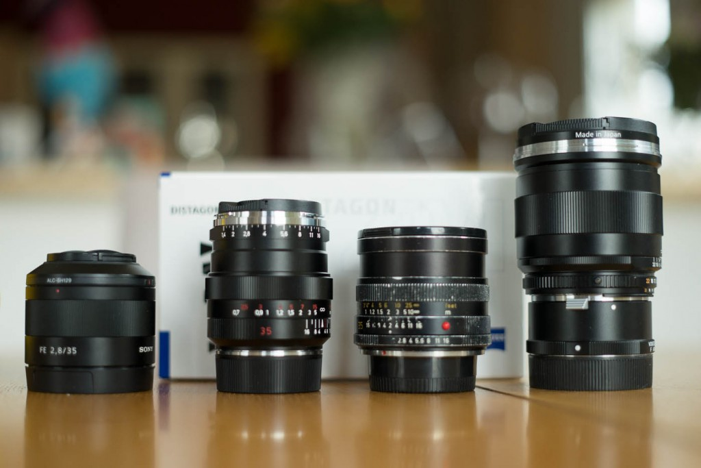 A group shot of a Sony 35/2.8 FE, Leica Summicron-R 35mm, Zeiss istagon ZM 35/1.4 and Zeiss Distagon 25/2