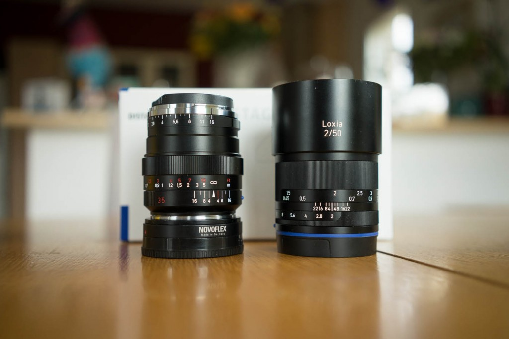A Zeiss Loxia 50/2 next to Zeiss's ZM 35mm f/1.4 lens