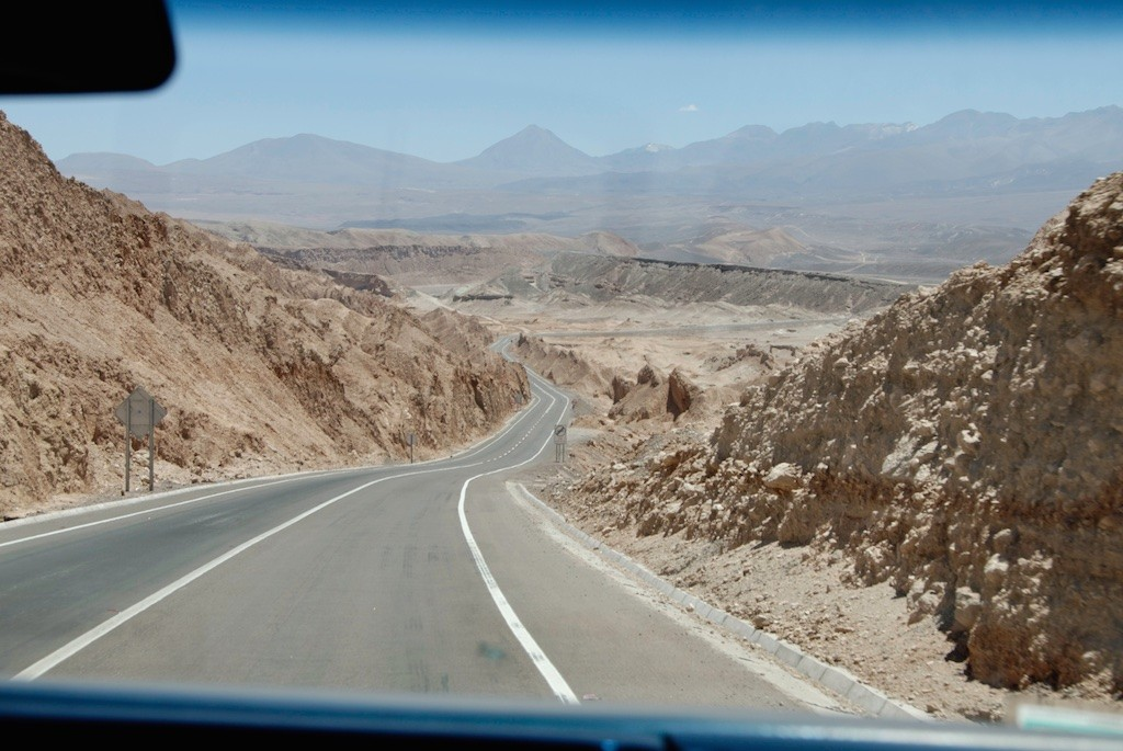 A mini-bus driving photographers through the Atacama desert