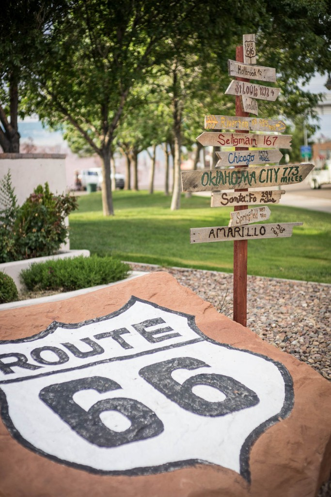 Route 66 sign and road signs in Holbrook