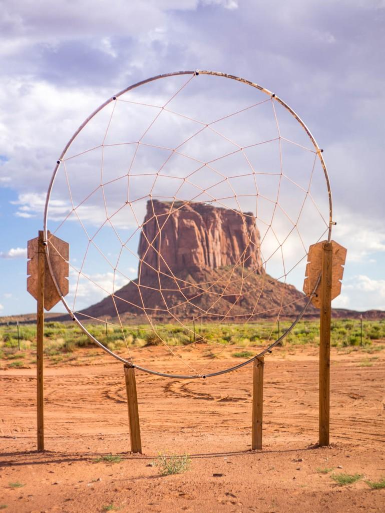 Monument Valley butte seen through a giant dreamcatcher.