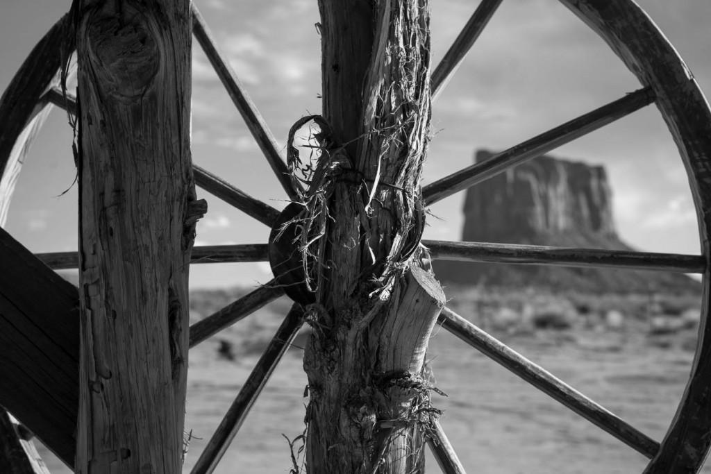 A Monument Valley butte seen through an old cartwheel