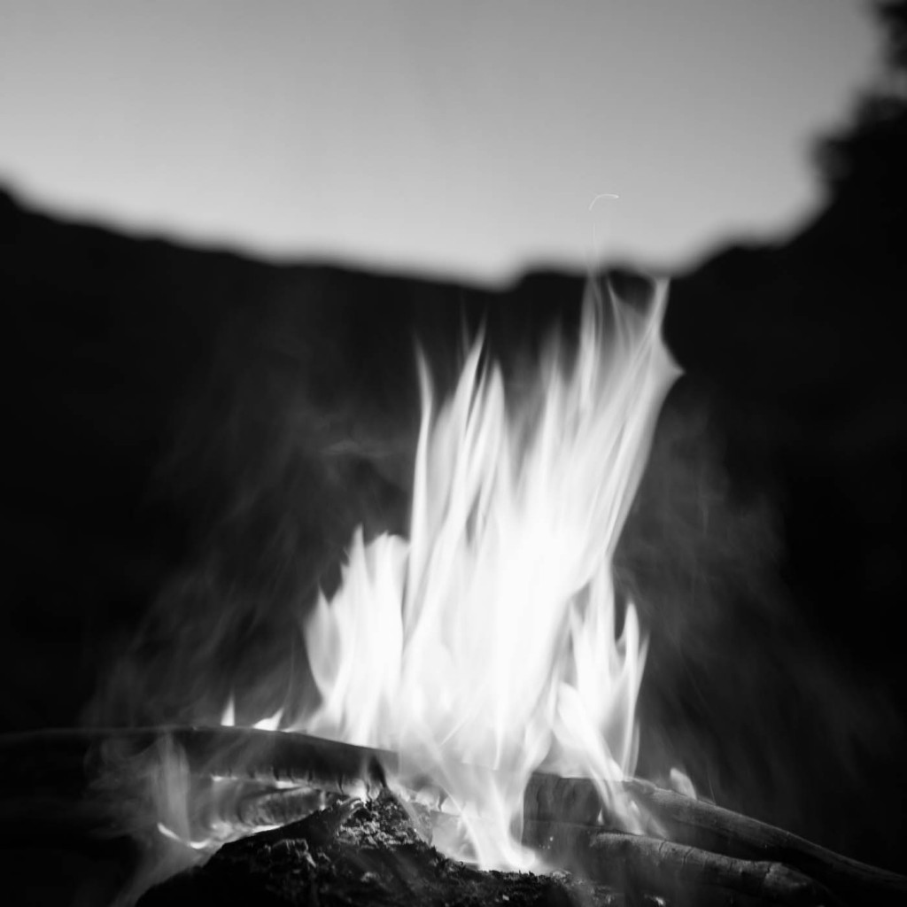 A campfire at night inside Canyon de Chelly