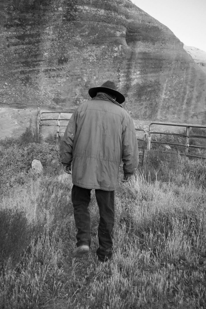 A Navajo guide attentding to horses inside Canyon de Chelly
