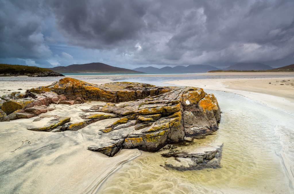 15 - South Harris - Gneiss Outcrop, the Island of Taransay and the Mountains of North Harris from Traigh Sheileboist