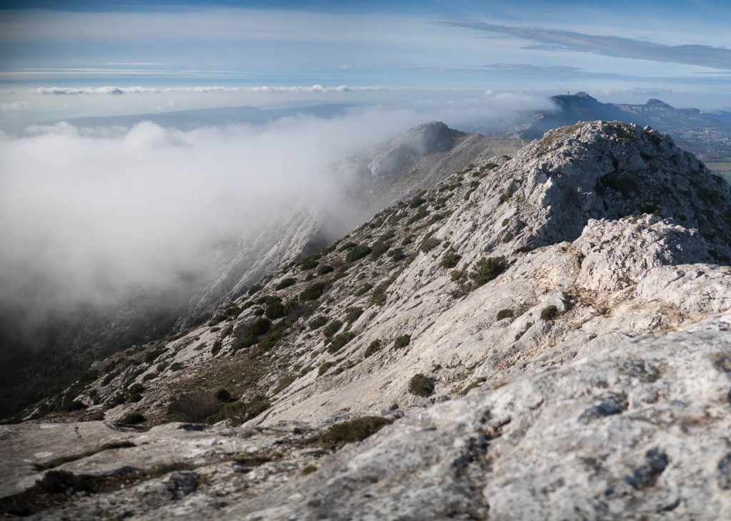 A sea of clouds slimbs the side of Sainte Baume in Provence