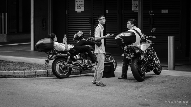 Delivery riders - Singapore. X-Pro2, 90mm f2 @ f4