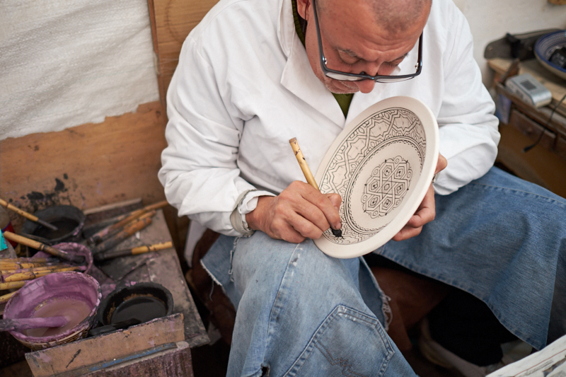Hand-painting pottery, Fez, Morocco. Fujifilm 23mm f:4 1:60s