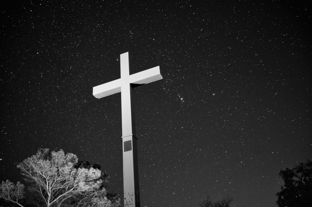 A cross on a hill top of Provence follows the photographic rule of thirds