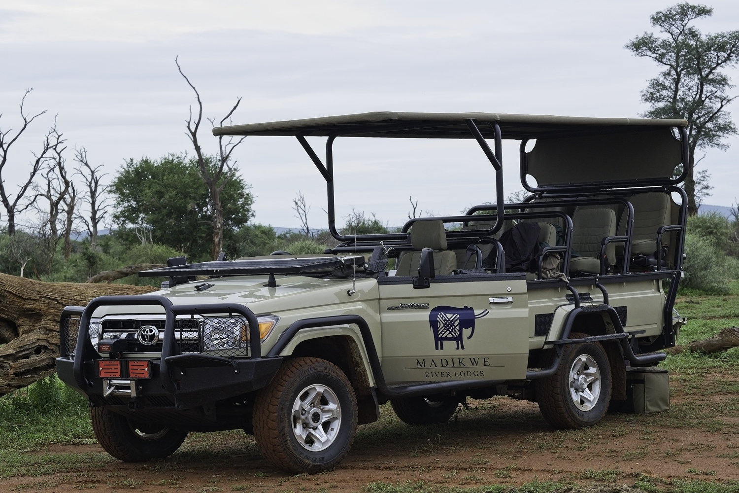 Typical game viewing vehicle - ours at Madikwe stopped for sundowners at a safe spot in the bush