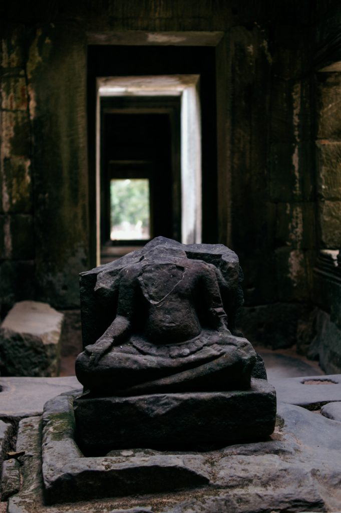 Buddhist statue inside the library of Preah Khan, Angkor