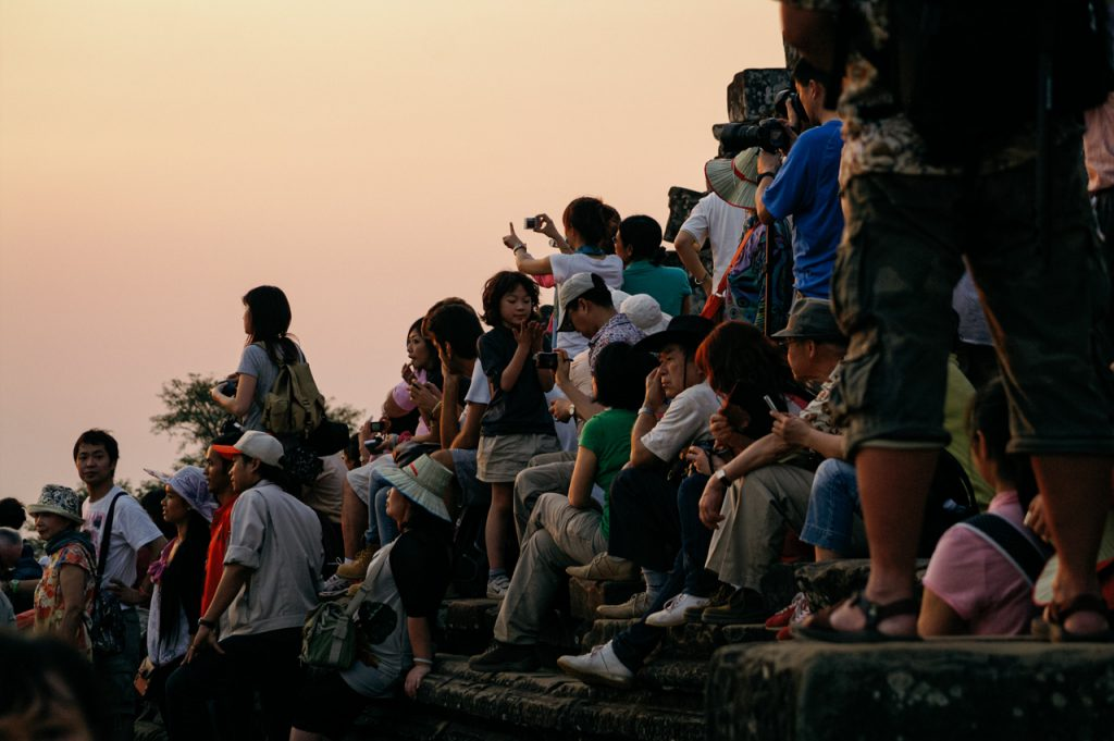 People at sunset on Phnom Bakheng temple mountain, Angkor