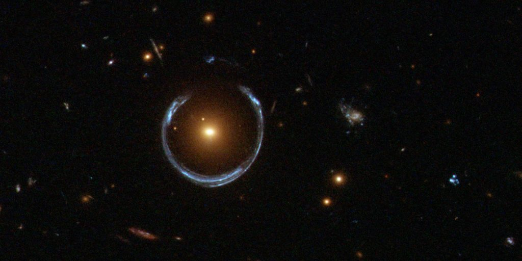 Gravitational lens, distorting the image of quasar into a ring, as imaged by ESA, NASA and Hubble.